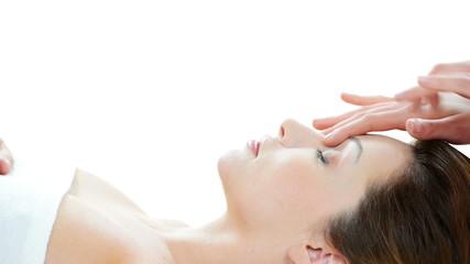 Woman enjoy receiving face massage