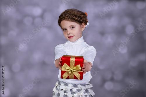 Little girl with gift in her hands