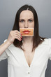 woman holding picture with big lips