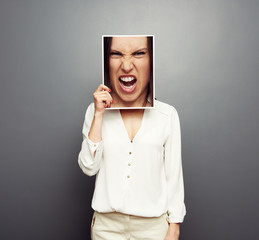 woman covering image with big angry face