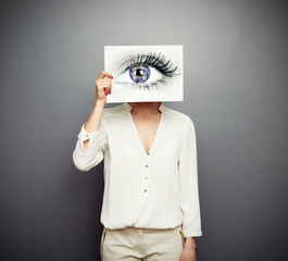 woman covering image with big eye