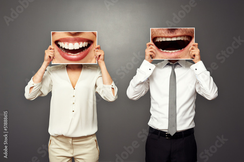photo of laughing merrily couple