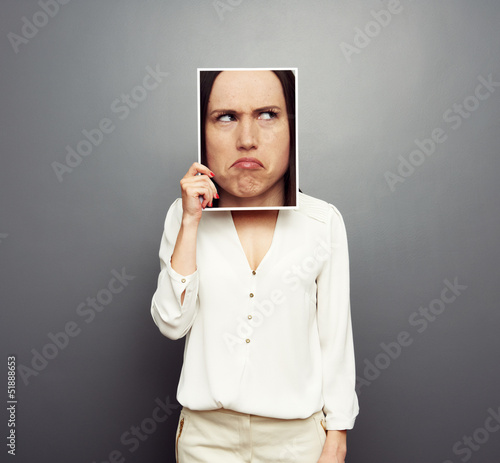 woman covering image with big pensive face