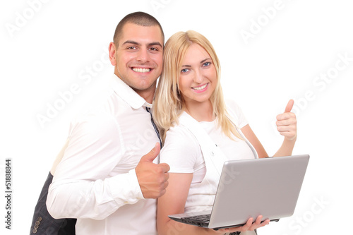 Happy man and woman with a laptop