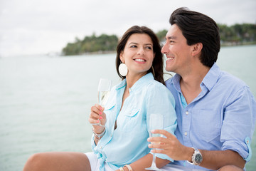 Summer couple drinking champagne