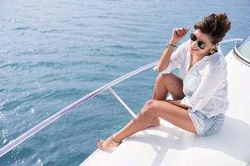 Woman sailing in a yacht