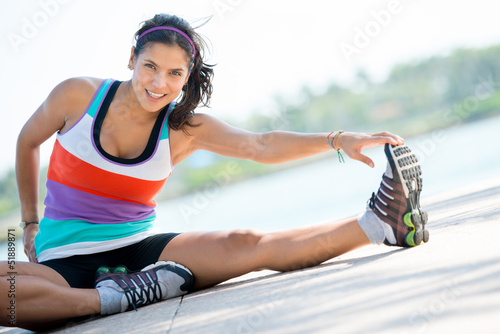 Athletic woman doing stretching exercises