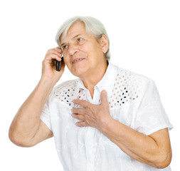 Portrait of a happy mature woman talking on cell phone. isolated