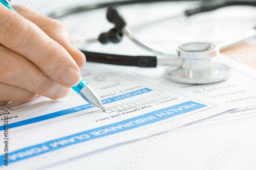 Doctor with Medical Claim Form and Stethoscope