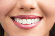 Extreme close up of female smile.