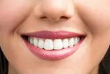 Fototapety Extreme close up of female smile.