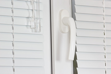 Handle white plastic office windows with shutters