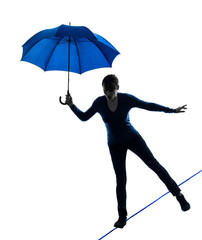 woman holding umbrella silhouette