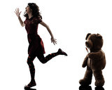 strange young woman and killer teddy bear silhouette