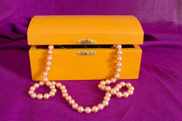 pearl necklace in an old box orange