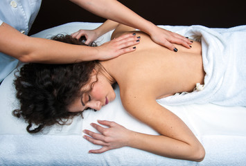 woman on massage table having back adjustment
