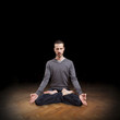 young man meditating in yoga position, meditation