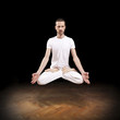 young man levitating in yoga position, meditation