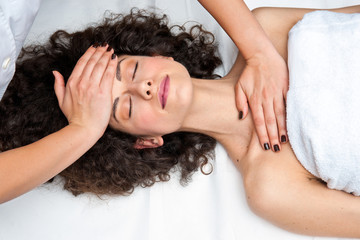woman having cyropractick neck adjustment