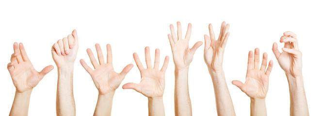 Viele Hände greifen verzweifelt nach oben