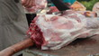 Butcher cutting fresh pork meat