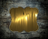 Old wood texture with gold nameplate