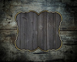 Wooden grunge texture with a nameplate of wood with gold trim