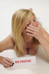 Woman holding HIV Positive notice