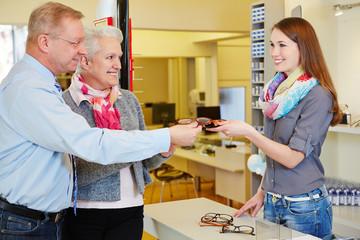 Senior couple buying glasses