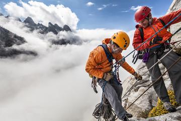 Climbing team rappelling.