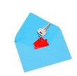 house symbol and key in open envelope