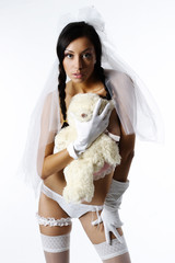 Attractive charming girl in lingerie holding a stuffed toy