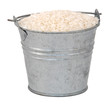 White long grain rice in a miniature metal bucket