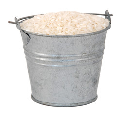 White long grain rice in a miniature metal bucket