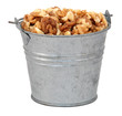 Chopped walnuts in a miniature metal bucket