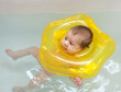 Newborn baby bathes in bath