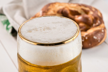Beer and bretzel, selective focus