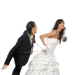 Bride pulling the groom on a chain