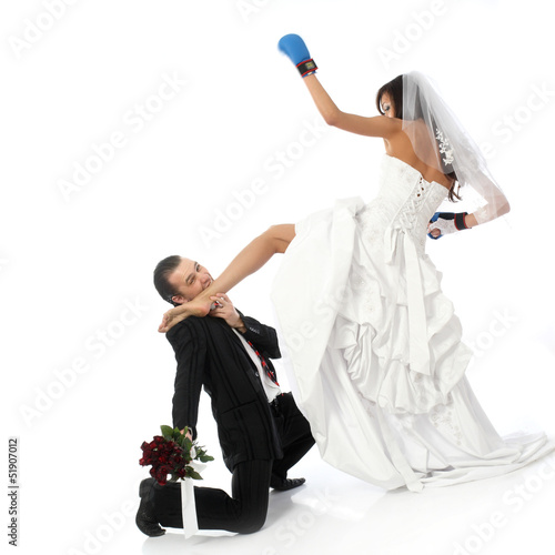 bride in a white wedding dress fightswith her fiance