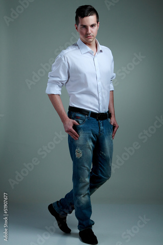 """photo of a young man in a full-length"""