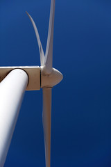 Wind turbine, close against blue sky