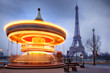 moving carousel close to Eiffel Tower, Paris
