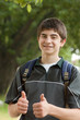 Teen boy student giving thumbs up