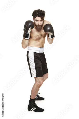 Male boxer in boxing stance ready to fight