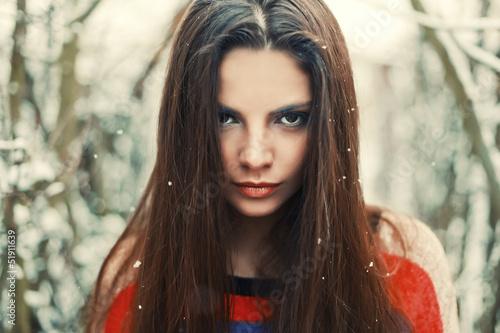 Fashion outdoor portrait of young serious woman