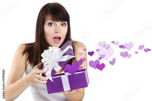 girl opens a box surprise of hearts