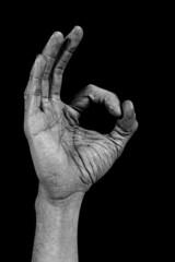 Hand on black back - zero