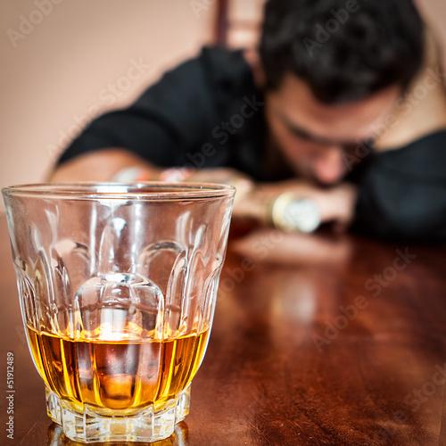 Drunk asleep man addicted to alcohol