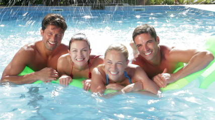 Group Of Friends Having Fun In Swimming Pool Together