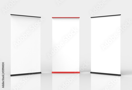 Three blank roll-up poster banner displays. Two black, one red.